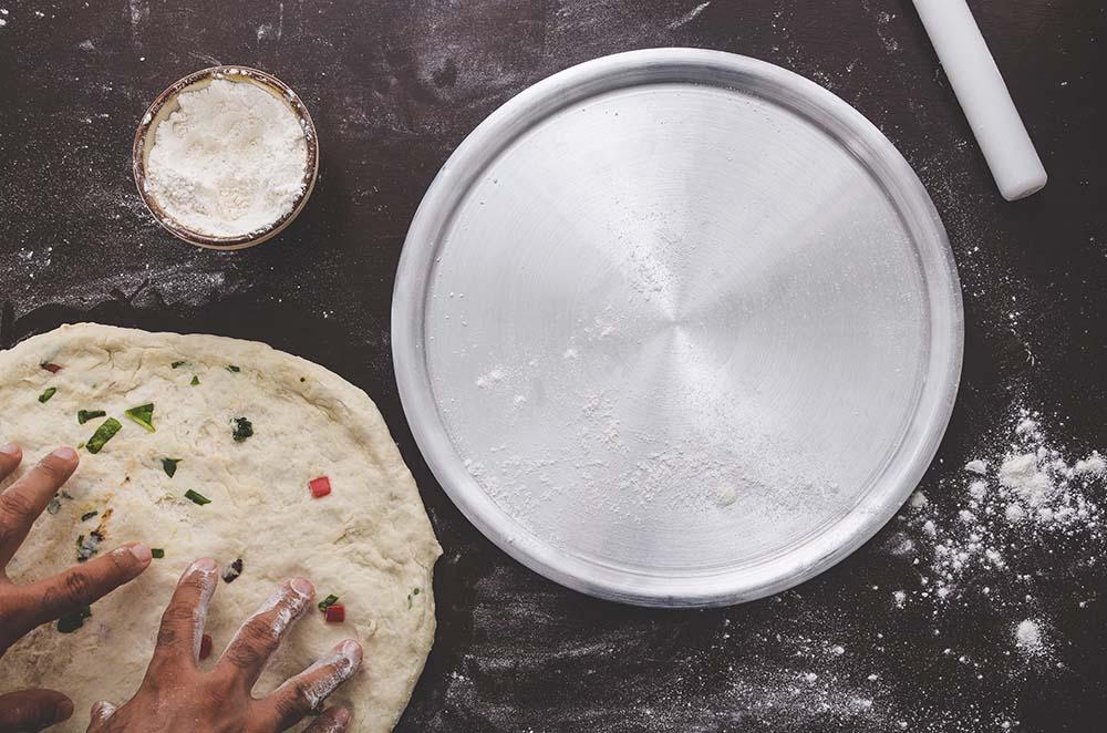 team building culinario pizza outdoors